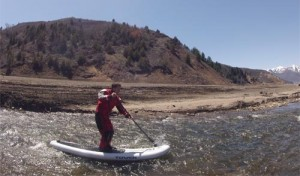 tower paddleboard running river rapids